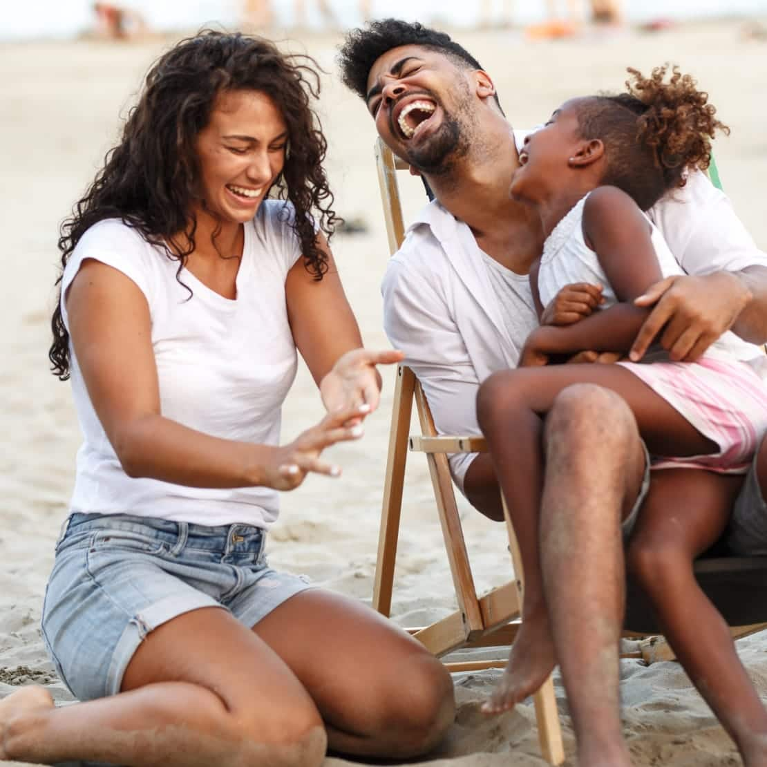 Family laughing at the beach